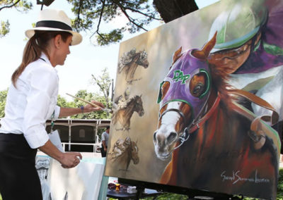 Official Triple Crown artist painting California Chrome in the Paddock at the Belmont Stakes