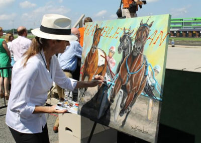 SUSAN PAINTING LIVE AS OFFICIAL ARTIST OF THE HAMBELTONIAN HARNESS RACE