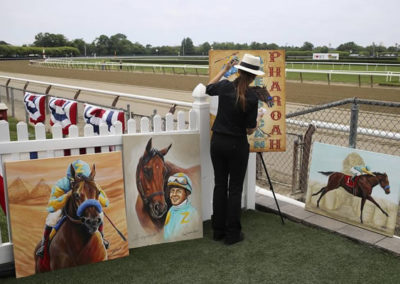 SUSAN PAINTING LIVE ON THE RAIL AS OFFICIAL TRIPLE CROWN ARTIST AND OFFICIAL AMERICAN PHAROAH ARTIST AT THE BELMONT STAKES