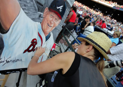 Susan Finishing a Painting of Bobby Cox at Sun Trust Park