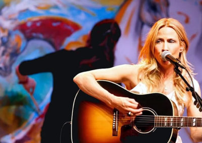 Susan Painting Live on Stage With Sheryl Crow