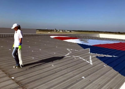 Susan Painting a Giant American Flag Mural at SGF Airport