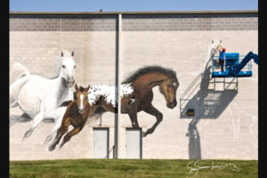 Susan Painting giant horses at the Campbell Ave 16