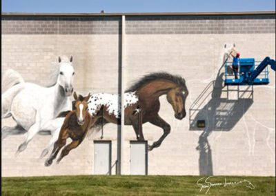 Susan Painting giant horses