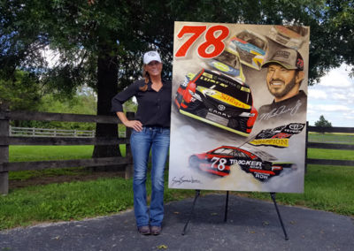 Susan displaying her NASCAR painting