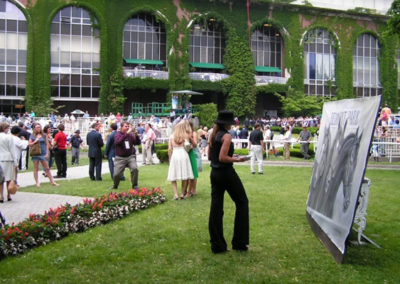 Susan painting LIVE in the paddock as Official Triple Crown Artist at the Belmont Stakes