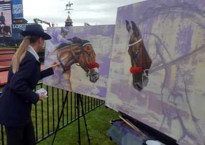 Susan painting Nyquist in the Stronach area next to the finish line as Official Artist of the Preakness
