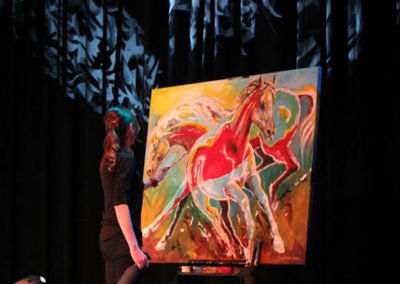 Susan painting live on stage Sheryl Crow concert