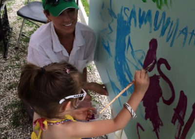 Susan painting with children with cancer and their families as official artist of the American Cancer Society's Cattle Barons Ball