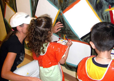 Susan painting with the children of the backstretch at the Belmont stakes