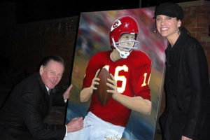 Susan's NFL Painting Being Signed by Len Dawson